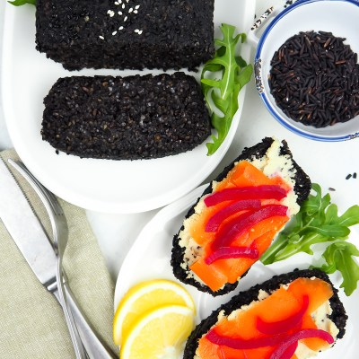 BLACK RICE BREAD WITH CARROT LOX, CREAM CHEESE AND PICKLED ONIONS