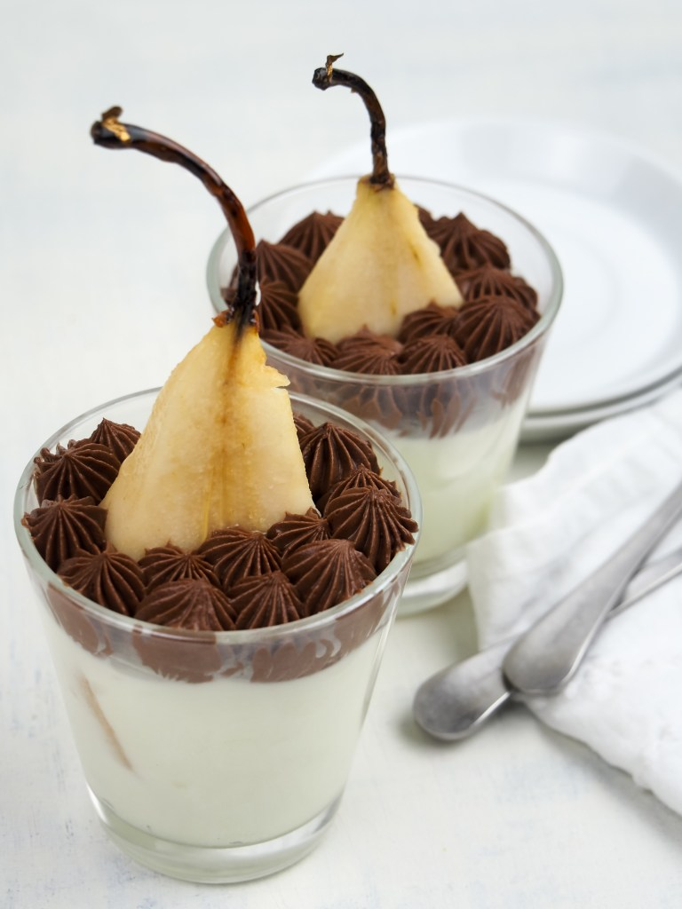 two cups with pear cheesecake