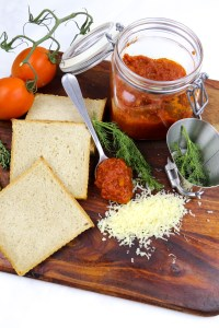 a jar with homemade tomato sauce, tomatoes and bread